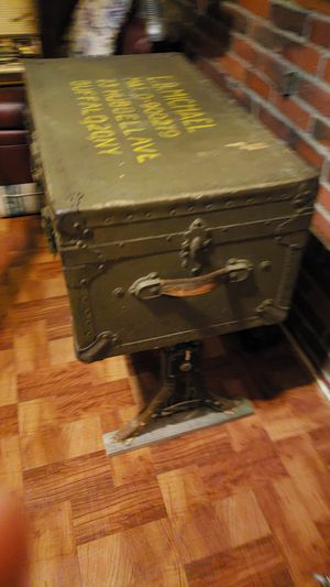 Antique army trunk convert in a nice looking cast iron legs table for Sale in Revere, MA