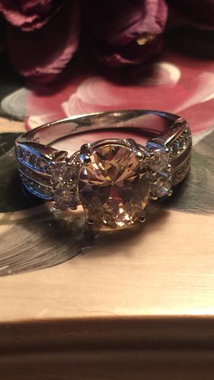 Pretty light pink Topaz on channel set band with white sapphires quality lab made on 925 sterling silver stamped band size8 for Sale in Northfield, OH
