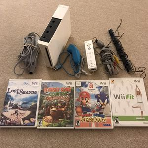 Nintendo Wii System console with 4 video games sonic mario donkey Kong wii fit controller cables for Sale in Burtonsville, MD