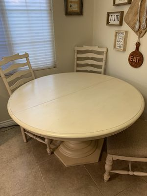 Cream antiqued kitchen table, seats 4-6 for Sale in Ontario, CA