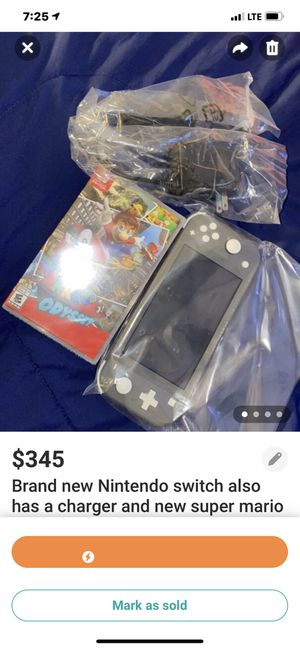 Brand new Nintendo switch also comes with a charger and the new super Mario game for Sale in South Euclid, OH