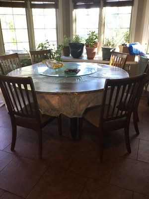 Round dining table with lazy Susan and matching chairs for Sale in Osage Beach, MO