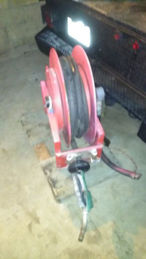 Diesel hose real auto retrackes it s heavey duty weight about hundred fifty pounds for Sale in Placentia, CA
