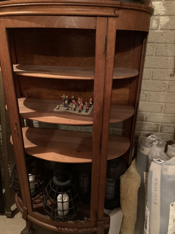 Curved glass, 4 shelf, antique china cabinet with claw feet. NO GLASS!!!