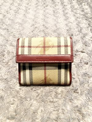 Vintage Burberry wallet paid $480 Authentic; normal wear. The edges of the wallet have signs of wear, and the lining is loose other then that good co for Sale in Washington, DC