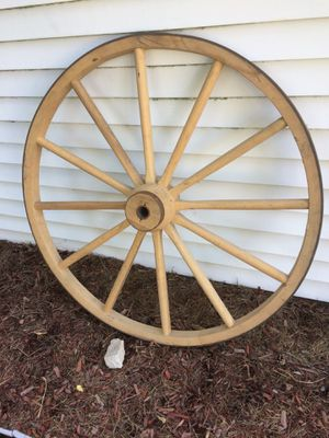 Professionally custom made wheels. 2 - 42 inch & 2 - 48 inch western style stagecoach wheels with 1 and 1/2 inch center. 8- 31 inch train wheels with for Sale in Hilbert, WI