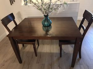 Heavy dining room table and 2 chairs l can deliver for a small fee for Sale in Lodi, CA