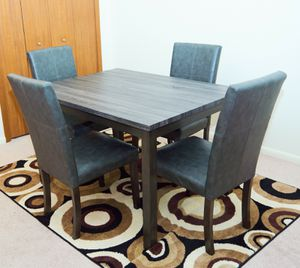 Casual dining table with 4 faux leather upholstered chairs for Sale in Strongsville, OH