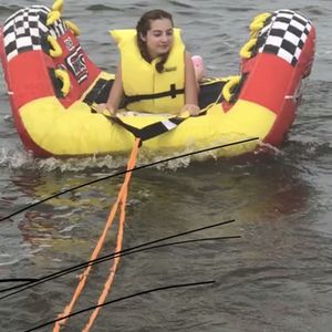 Water Raft,red One Can Pull Behind A Boat Seats 4 for Sale in Miami, FL