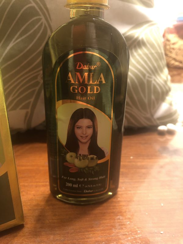 Alma oil, with amla, almond and henna oil.
