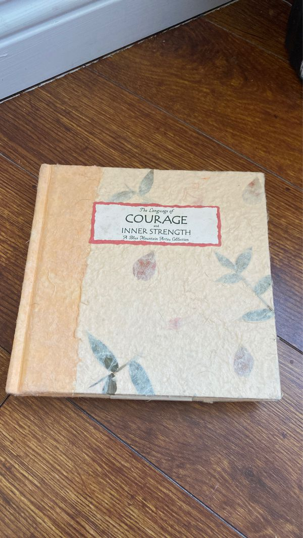 Two poetry books with quotes