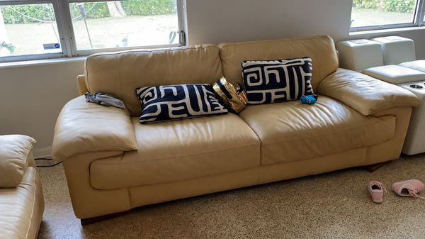 Pale yellow leather sofas