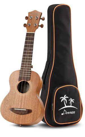 Guitar (Ukulele) Donner mini guitar w/bag for Sale in El Cajon, CA