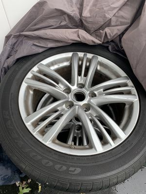 Infiniti g37 2011 stock rims and tires good condo come check them out size 17s for Sale in Providence, RI