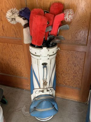 Old golf clubs and bag, kids bag, and adult travel protective bag for Sale in Richland, WA