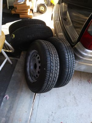Three 14 inch tires with rims 75.00 for Sale in Lawrenceville, GA