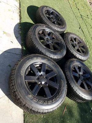 5 black jeep rims and tires 5.127 lug pattern for Sale in San Bernardino, CA