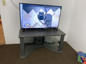 Tv stand holds up to 60 inch ** TV NOT INCLUDED ** for Sale in Central Falls, RI