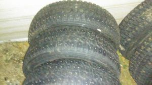 Snow tires on 92 subaru wheels for Sale in Wenatchee, WA