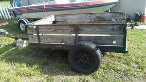 5 x7 metal trailer w wood sideboards for Sale in Haines City, FL