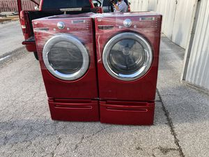 LG washer and dryer set front loads red in good condition for Sale in San Antonio, TX