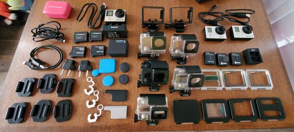 Lot of Gopro Hero 4 Black, 3 Silver+, and 3 White includes all shown accessories