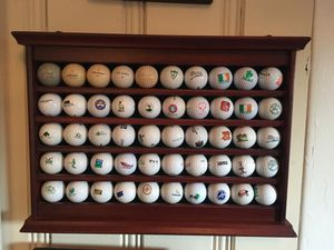 50 Golf Ball Collection And Rack. Collectors Items for Sale in Catonsville, MD