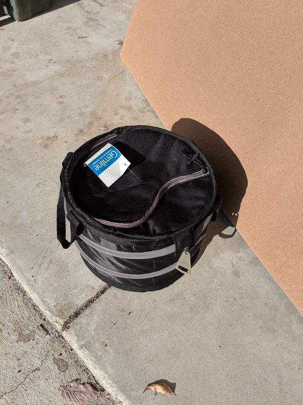 Collapsible cooler with retractable bottle opener