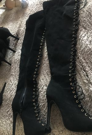 Thigh high black suede boots Super Bowl it's laced up size a brand new open box never worn for Sale in Orlando, FL