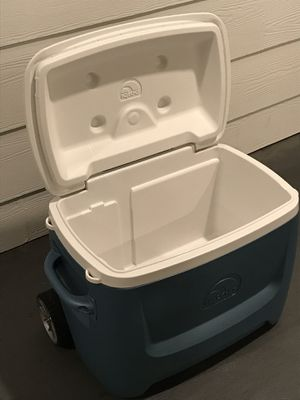 2 Huge igloo coolers with wheels and handle grey gray clean one is new other one used for Sale in Jacksonville, FL