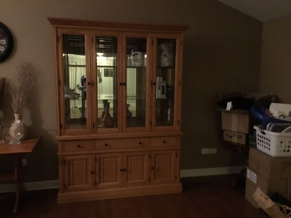 """China cabinet in mint condition with lights,2 piece. 64""""x87"""""""