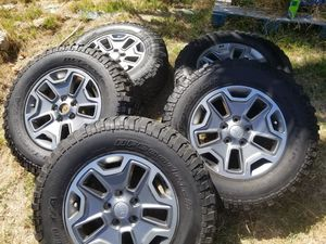 JEEP CHEROKEE FACTORY WHEELS W/ TIRES. SET OF 5. XLNT CONDITION for Sale in Vista, CA