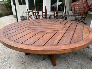 Wood table with lazy Susan & 10 chairs for Sale in Los Angeles, CA