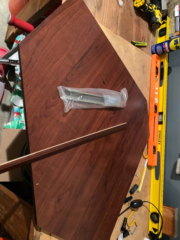 Free - Closetmaid Corner shelf. New with hardware - without box.