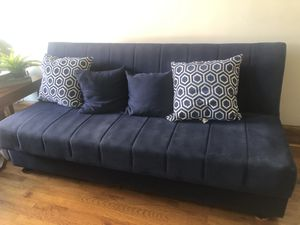 Navy blue Couch folds open into bed for Sale in Brooklyn, NY