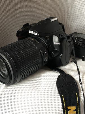 Nikon D3000 digital camera with 55-200 mm lens with 3 batteries and 2 chargers for Sale in Bridgeport, CT