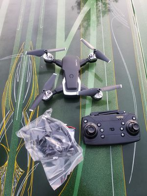 Hjhrc drone with controller battery gaurds and charger for Sale in Kirkland, WA