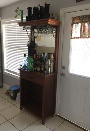 Antique Bar with wine rack and glass holder. for Sale in Tampa, FL