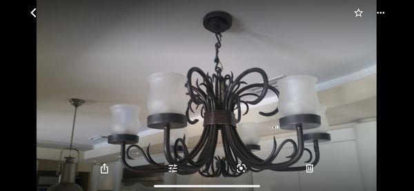 Artistic Wrought Iron Chandelier by designer Alexandra Diez. Lampara para la venta.