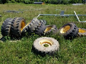Individual rim and tire for skid steer loader for Sale in Washington, PA