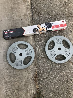 Weight lifting bar with 25 plates for Sale in Pico Rivera, CA