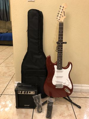 Fever electric guitar package come with amplifier soft case strap and cable for Sale in Bell, CA