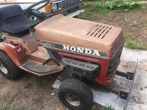 As seen on pictures mini tractor for yard work very very strong and handy new tire new inner tube new battery key start right up for Sale in Spartanburg, SC