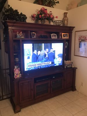 Entertainment center holds 55 inch TV for Sale in West Palm Beach, FL
