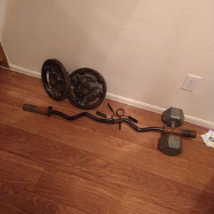 Curl Bar And 2 25 Lb Plates And 40 Lb Dumbell for Sale in Glendale, AZ