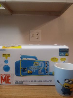 Despicable Me Portable Sing A Long radio CD player with Mug for Sale in Orlando, FL