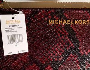 Michel Kors wristlet snakeskin for Sale in Dallas, TX
