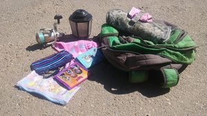 Odds and Ends. Fishing reel, girls purses, backpack, toiletry bag, girls snow cap, porch lantern, Etc. for Sale in Riverside, CA