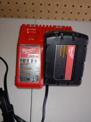 Milwaukee XC 4.0 Battery & Rapid charger for Sale in Fairview, TX