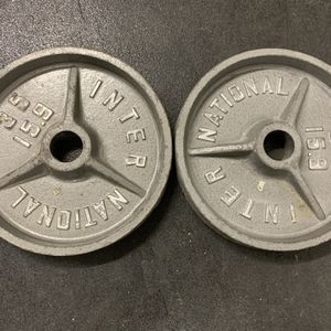 35 lb Olympic Deep Dish plates and Curl bar for Sale in Mundelein, IL